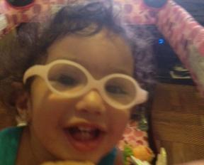 Lauren, 16 month old, she wears glasses for farsightedness.  Glasses are Miraflex.