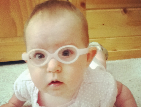 4 month old, she wears glasses for myopia and isotropia.  Glasses are Miraflex.