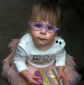 18 month old girl wearing glasses