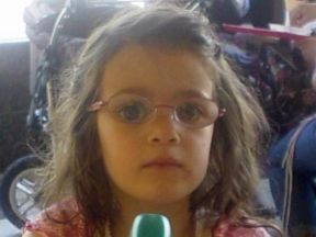 picture of a 3 year old girl wearing glasses