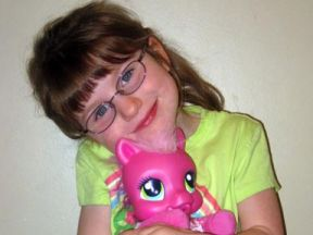 picture of 4 year old girl wearing glasses