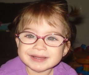 toddler girl in glasses for farsightedness