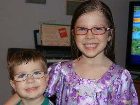 siblings wearing glasses