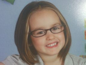 Allyson, 4 years old.  She wears glasses for farsightedness.  The glasses came from Walmart.