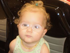 picture of a little girl wearing glasses