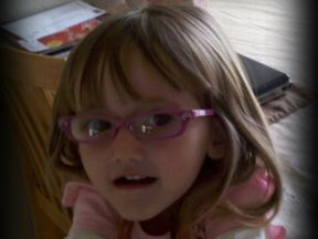picture of a toddler girl in glasses