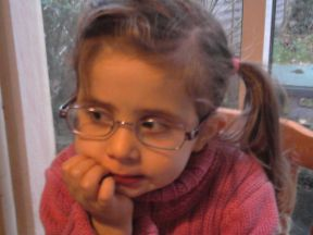 picture of a girl wearing glasses