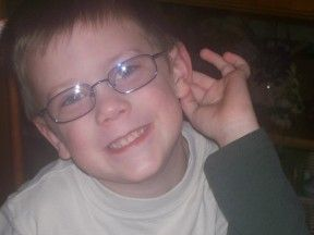 picture of a 5 year old boy in glasses