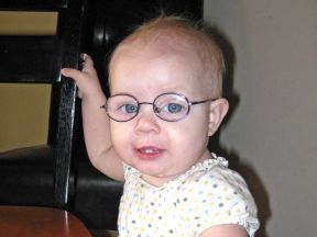 baby girl wearing glasses, 12 months old