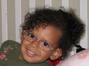 Brooklynn - 3 1/2, she has been wearing glasses since she was 2 for amblyopia and extreme nearsightedness, and patches 8 hours a day.  Glasses are Fisher-Price.