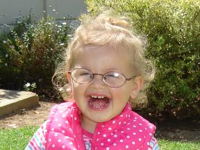 picture of a toddler girl in glasses for farsightedness