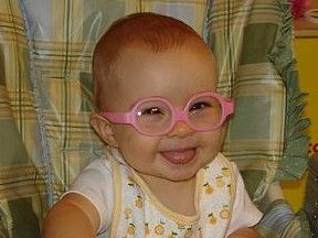 picture of a baby wearing glasses for farsightedness