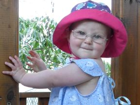 picture of a baby girl in glasses for farsightedness