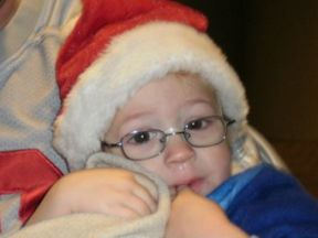 picture of a young boy wearing glasses