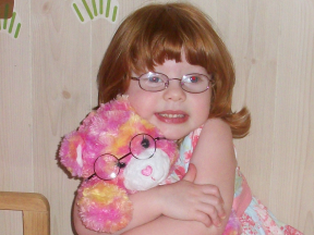 Destiny, 3 years old. She wears glasses for farsightedness The bear's glasses are from Build-a-Bear.