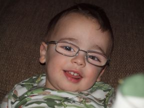 picture of a toddler boy wearing glasses for farsightedness