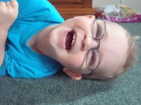 Eli, 22 months.  He wears glasses for farsightedness.