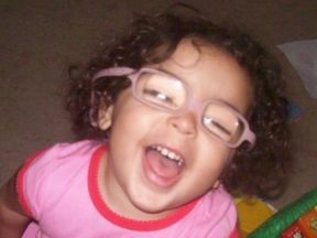 picture of a young girl who wears glasses for cataracts