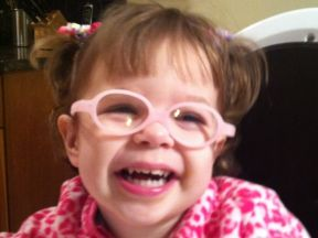 picture of a toddler girl wearing glasses for astigmatism