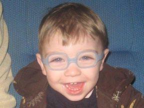 toddler boy wearing glasses.
