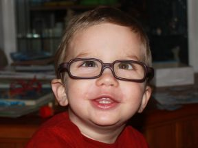 Elliot, 21 months old. He wears glasses for esotropia and farsightedness. This is his first day wearing glasses- they are by Miraflex.