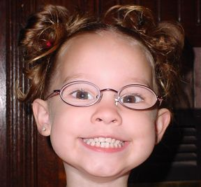 toddler girl who wears glasses for farsightedness and astigmatism