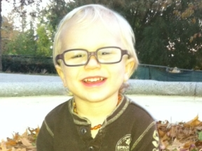 Jax, 2 years old.  He wears glasses for farsightedness.  Frames are Miraflex and lenses are Trivex.