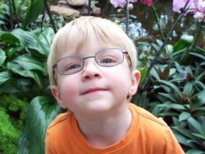 young boy in glasses