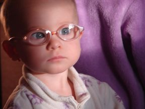 Jillian, 15 months.  She wears glasses for farsightedness.  Her frames are pink PEZ