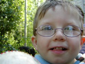 picture of 3 year old boy wearing glasses