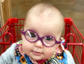 photo of a baby wearing glasses for strabismus