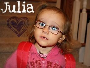picture of a two year old girl in glasses
