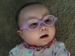 Julia Leigh, 6 months old.  She wears glasses for farsightedness and astigmatism.  Her frames are Miraflex.