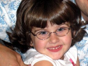 photo of a 3 year old girl wearing glasses