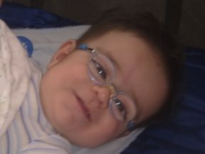 baby boy wearing glasses for cataracts