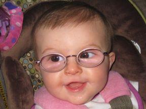 baby girl wearing glasses for farsightedness