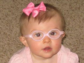 picture of a baby girl in glasses