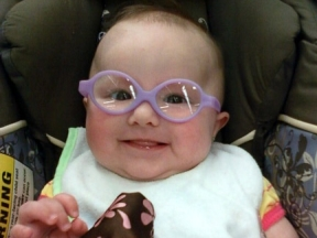 Kendyl, 5 months old. Just minutes after getting her glasses for hyperopia, astigmatism, and intermittent strabismus. They are Miraflex.