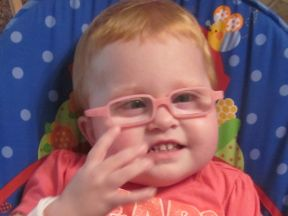 young toddler girl wearing glasses for farsightedness