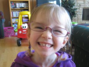 Layla, 3 years old.  She wears glasses for strabismus and farsightedness.  Glasses are Ray bans from Lens crafters.