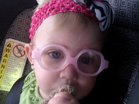 baby wearing glasses for farsightedness