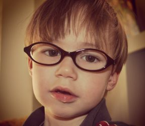photo of a toddler boy in glasses