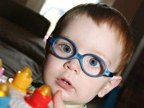 picture of a toddler boy in glasses