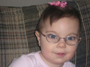 Lily, - wears glasses for extreme farsightedness.