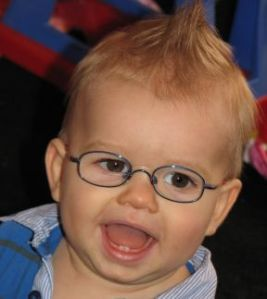 Lincoln, 12 months old. He has been wearing glasses since 10 months old for farsightedness and his frames are from OiO Eschenbach.