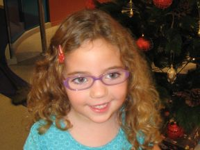 picture of a four year old girl in glasses