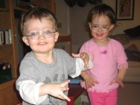 Michael and Mariana, 28 months - they both wear glasses for high nearsightedness.  Glasses are Fisher Price.