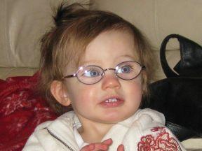 Makenna, 16 months. She wears glasses for farsightedness (+9 in each eye).