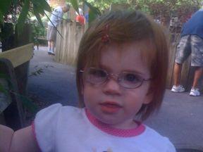 toddler girl wearing glasses for farsightedness