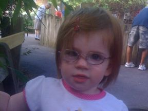 toddler girl wearing glasses for farsightedness